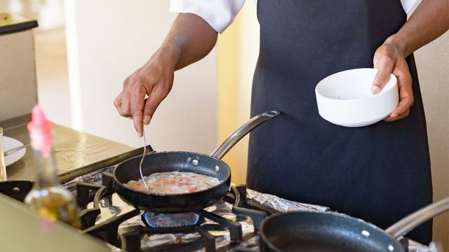 Man cooking eggs