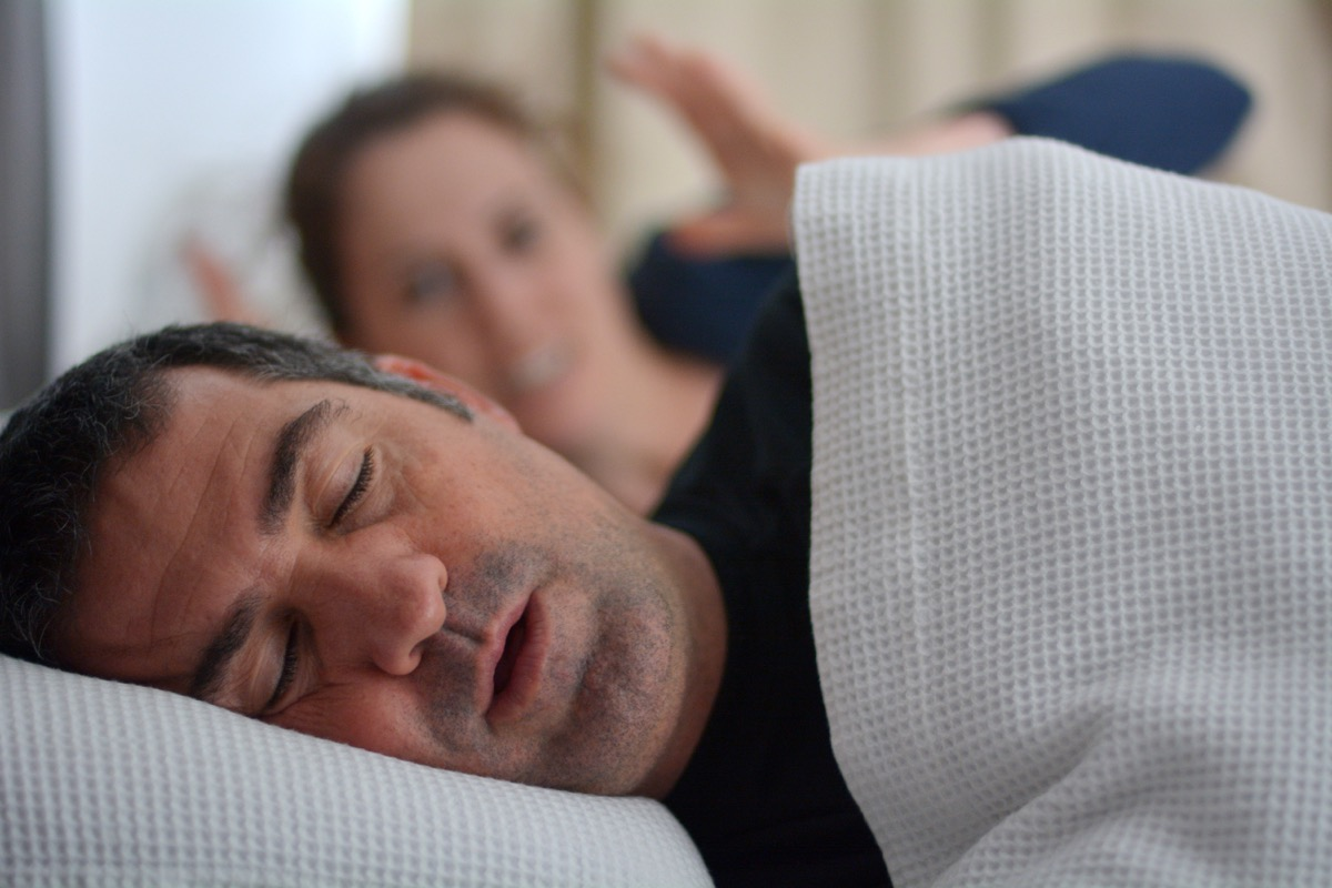 Woman (age 30) suffers from her male partner (age 40) snoring in bed