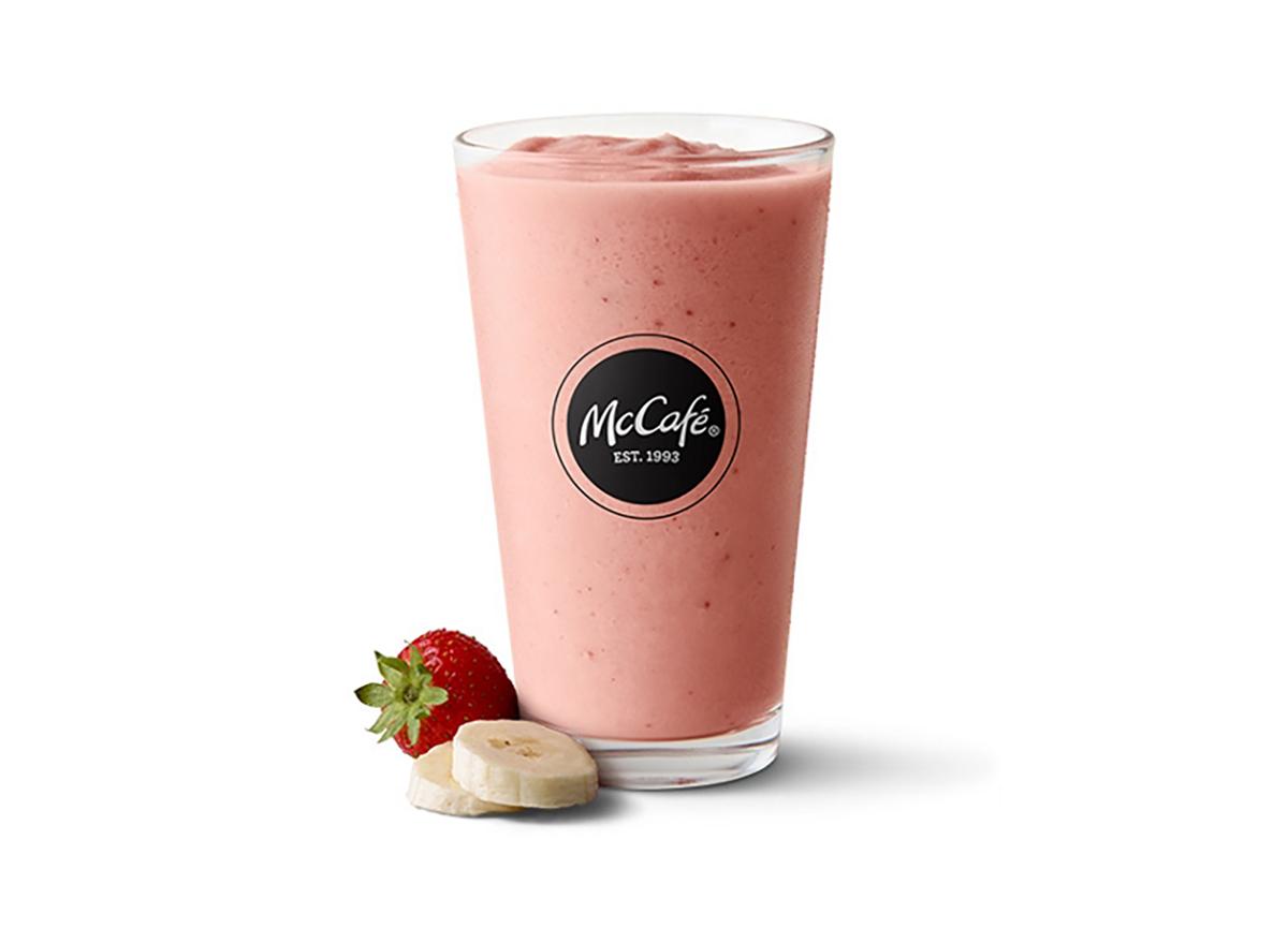 mcdonalds strawberry banana smoothie glass on white background