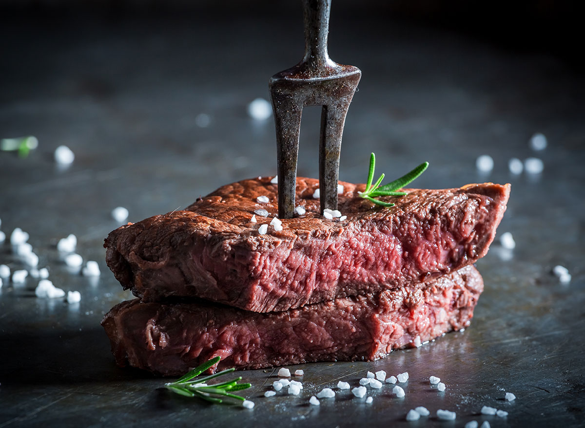 medium rare cooked steak metal fork with salt