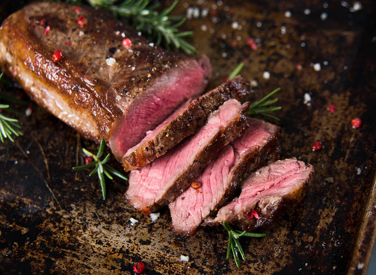 new york strip steak medium rare on baking sheet