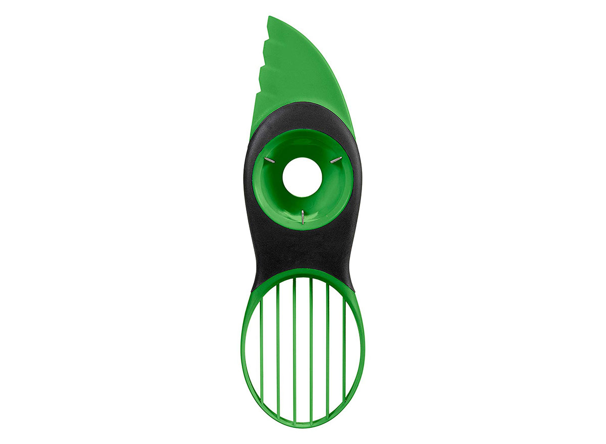 oxo green and black avocado slicer pitter cutter tool