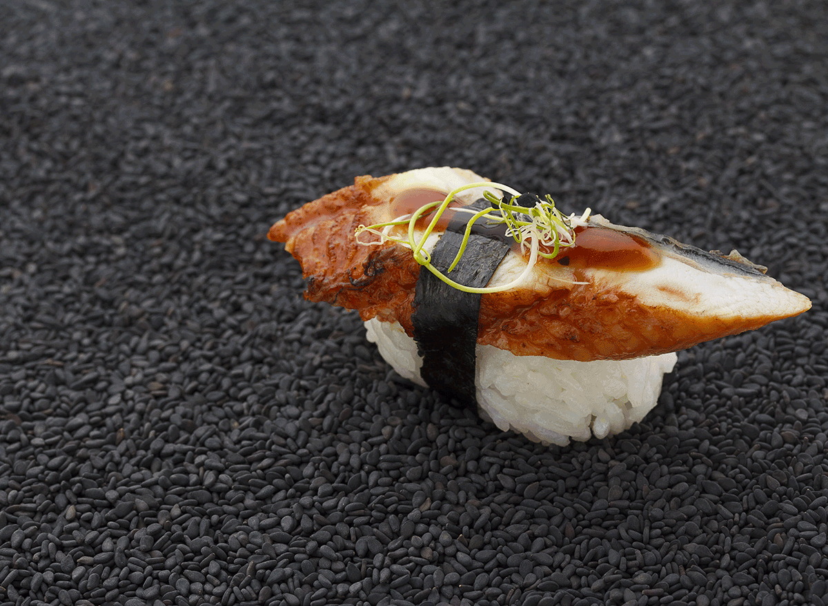 piece of eel on top of sushi rice