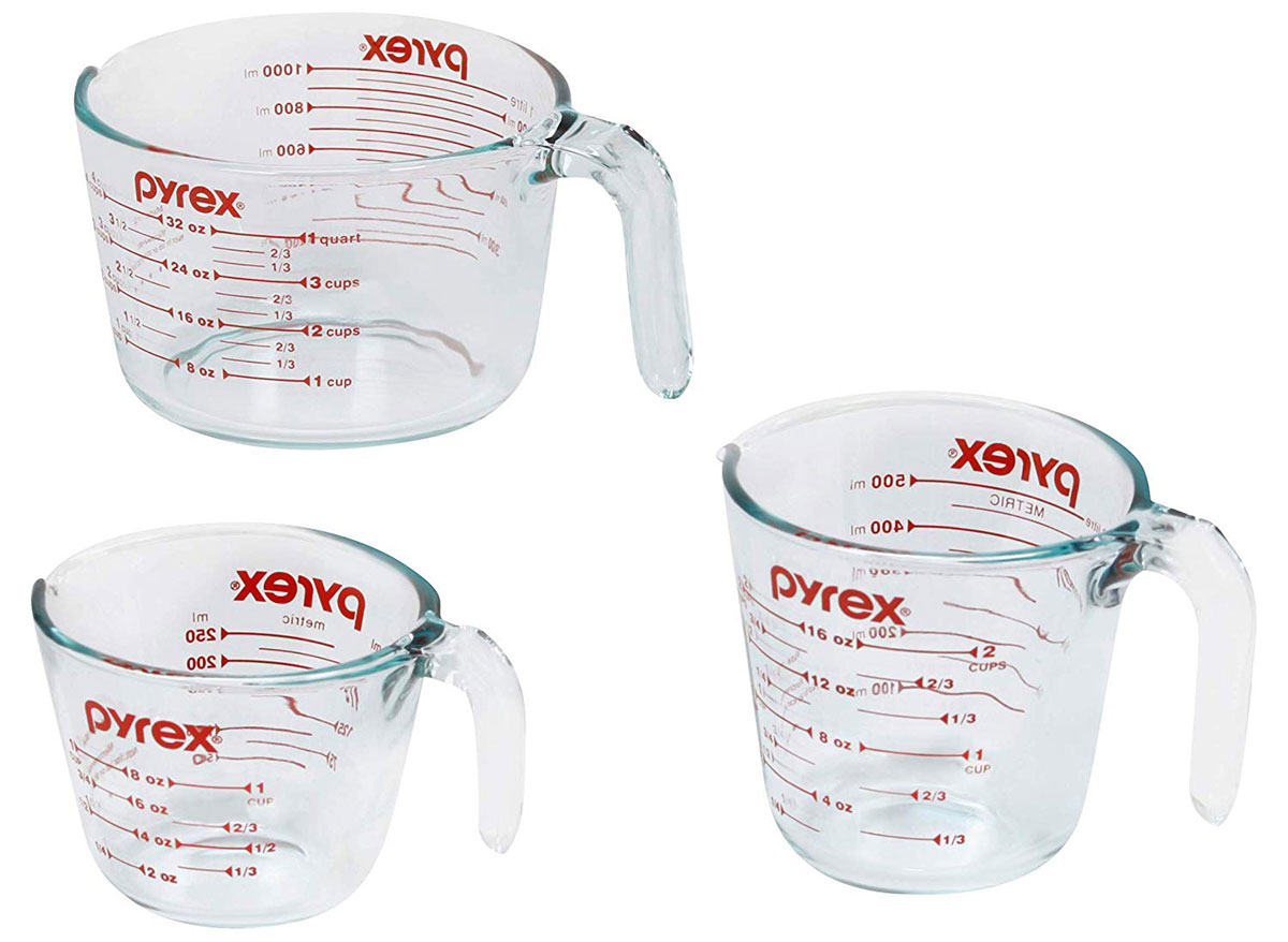 three empty pyrex glass measuring cups