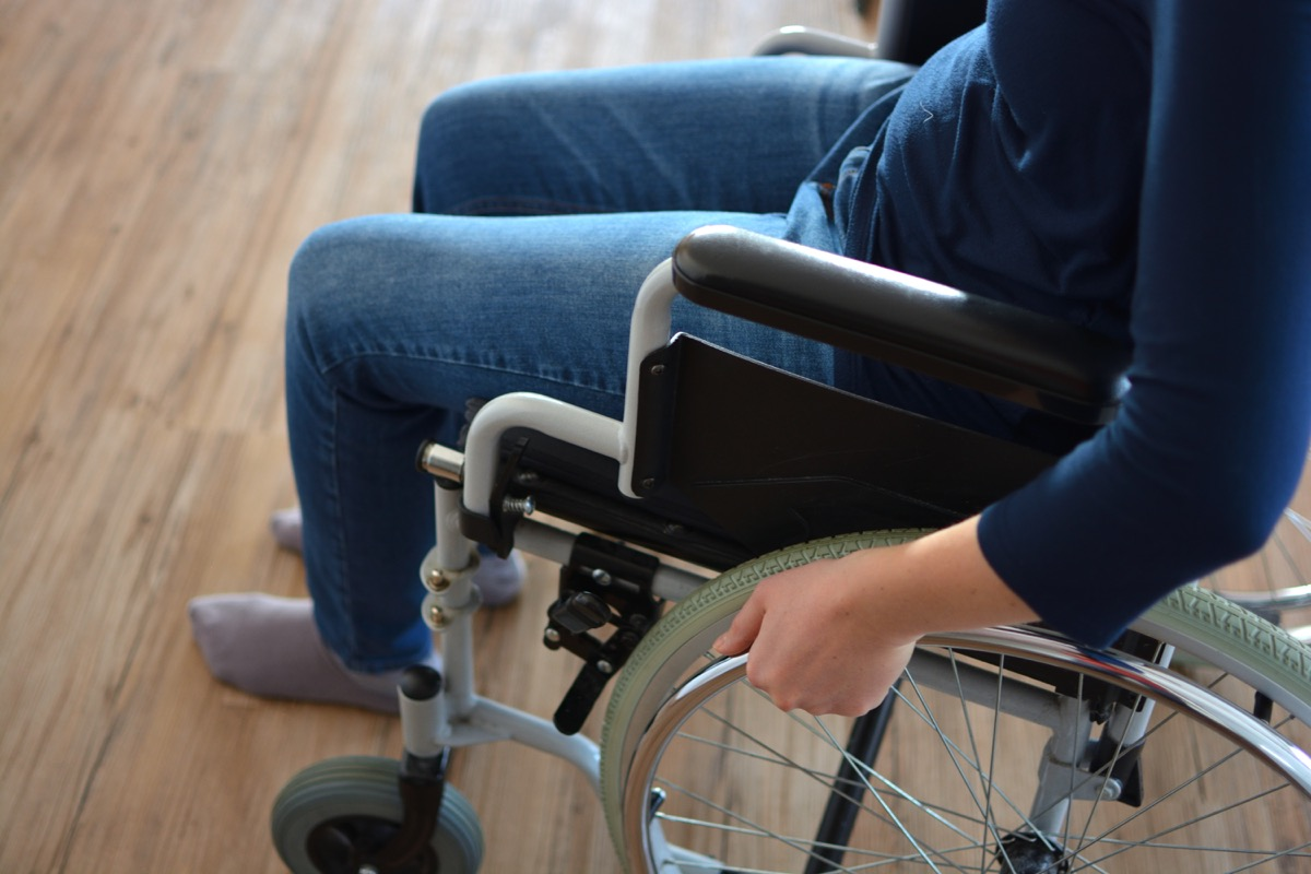 Young woman sitting in a wheelchair
