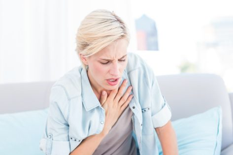 Woman having breath difficulties in the living room - Image