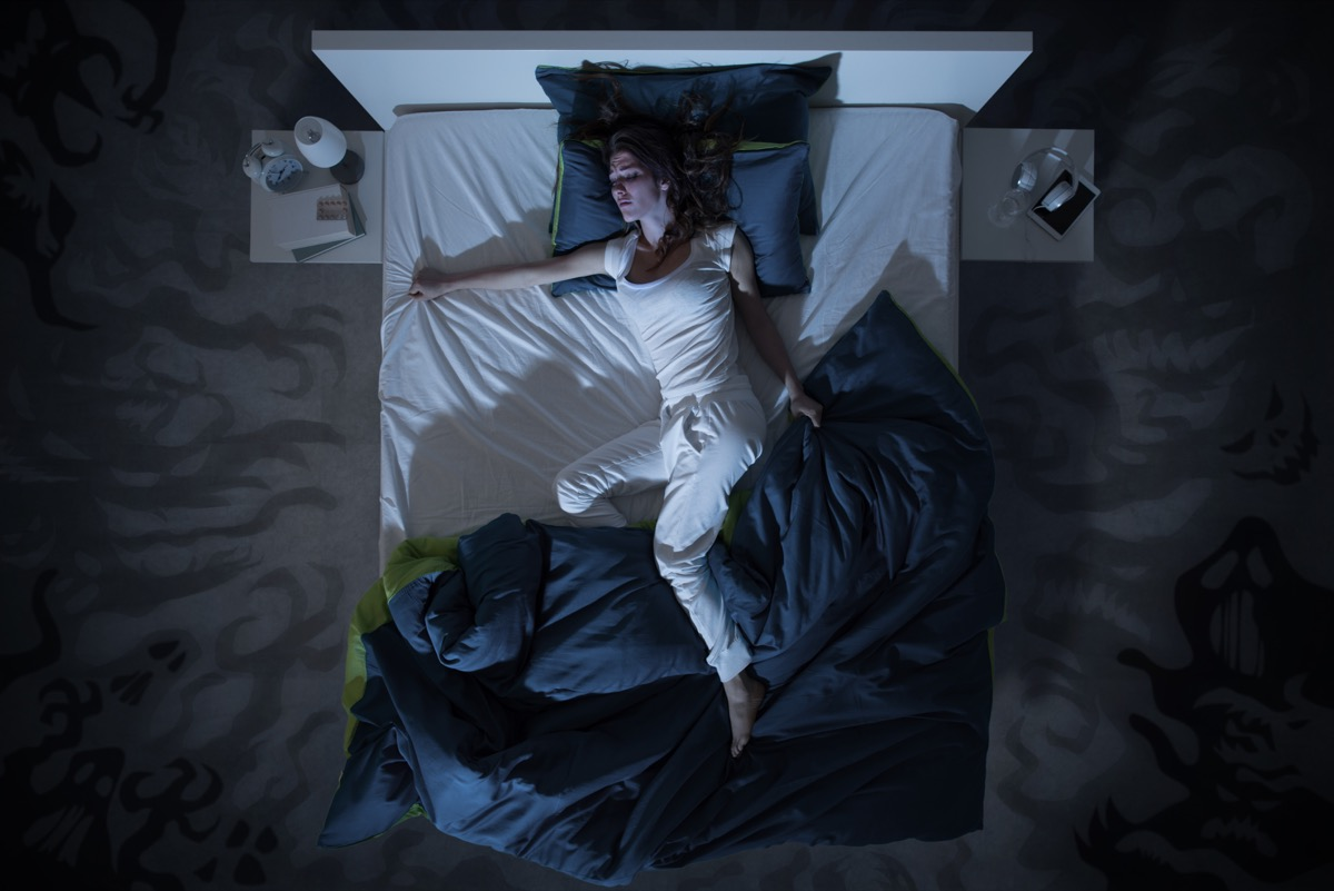 Woman in bed restless.