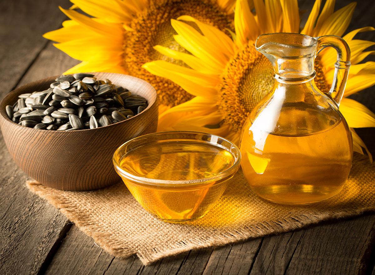 sunflower oil in bowls on burlap