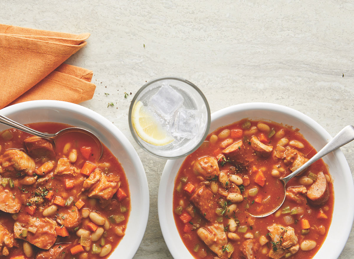 slow cooked turkey cassoulet in white bowls