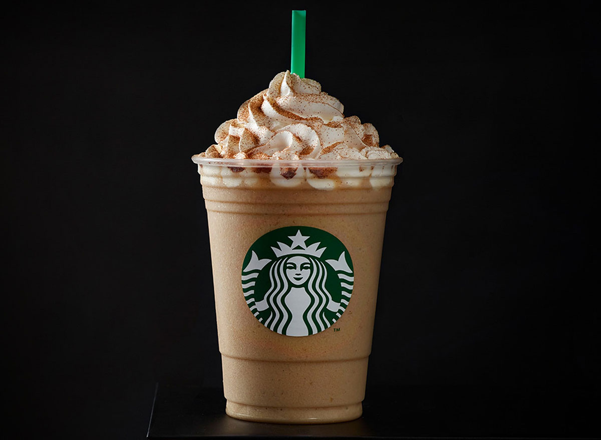starbucks cinnamon roll frappuccino on black background