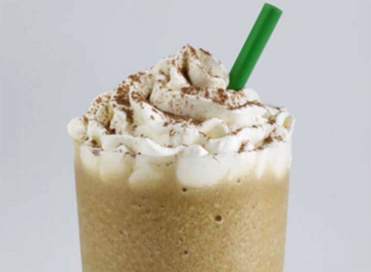 starbucks tiramisu frappuccino with green straw on gray background
