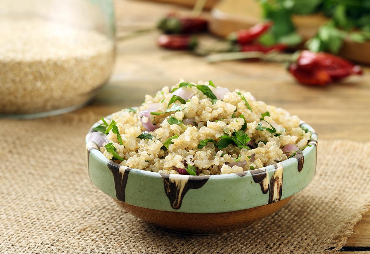 vegan quinoa salad in ceramic bowl