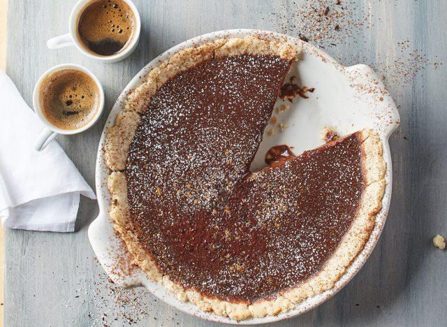 warm mocha tart with espresso cups and napkin