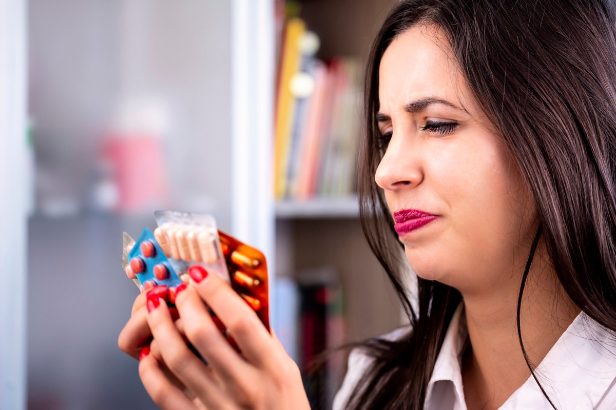 woman holds medications