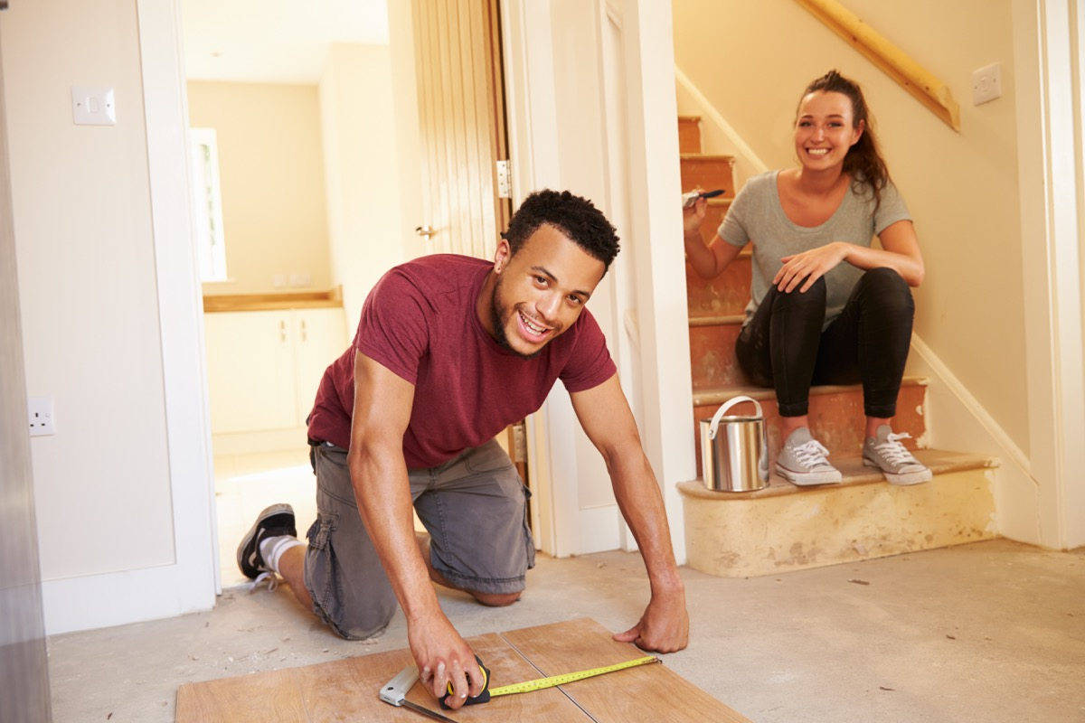 homeowners decorating their house