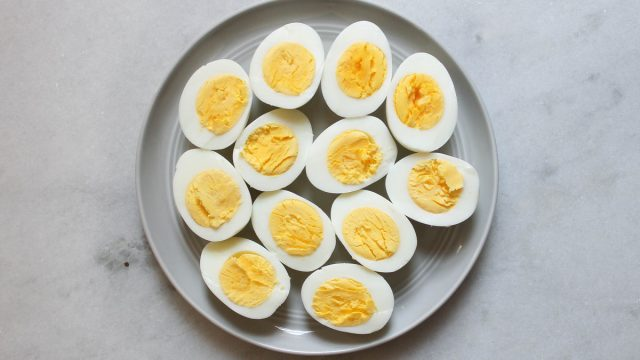 hard boiled eggs on a plate cut in half
