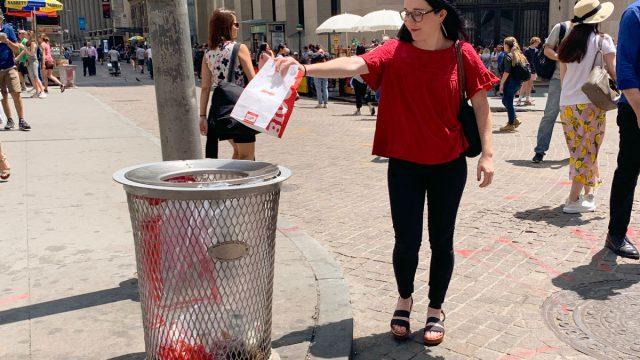 ann marie throwing away fast food bag on the street for fast food cleanse