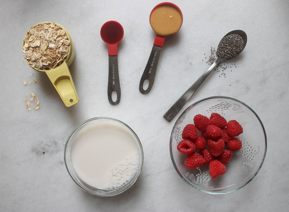 ingredients for overnight oats on a marble counter