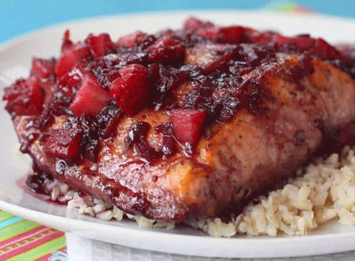 strawberry red wine glazed salmon on a plate of rice