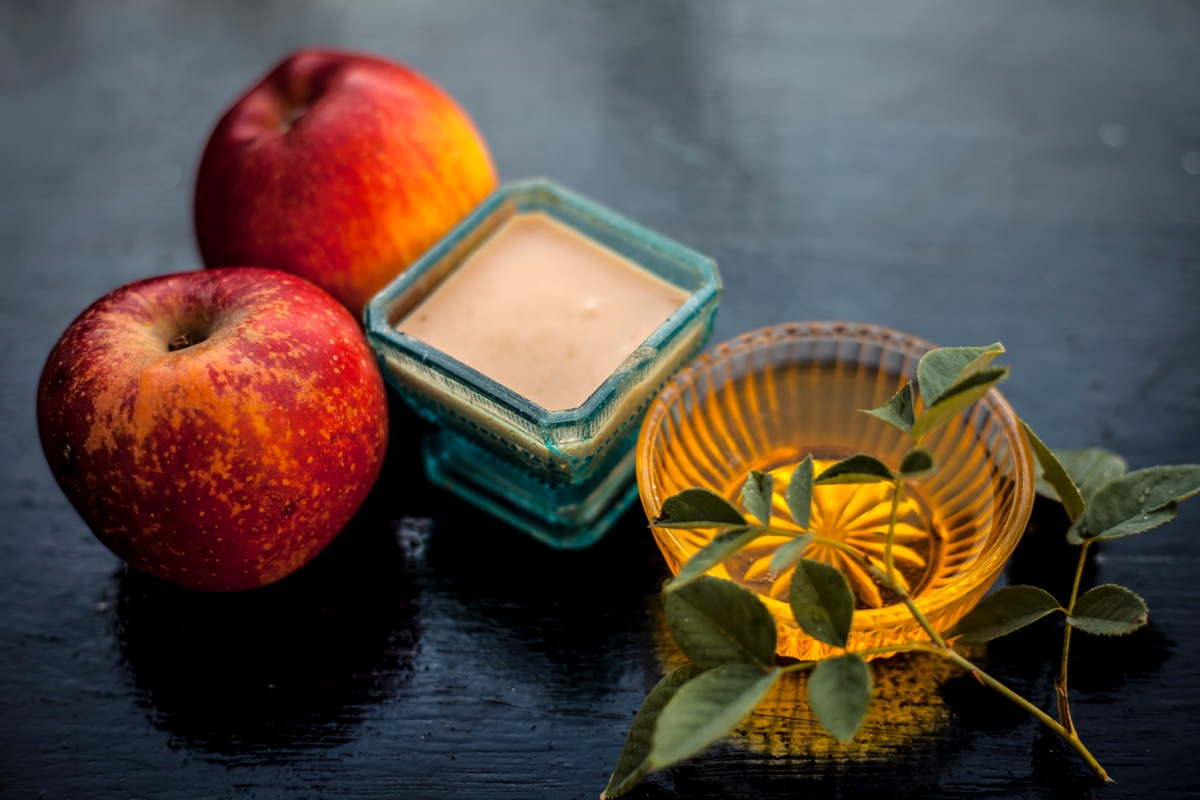 apple pulp mixed with honey to normalize skin which becomes dry in winter on wooden surface
