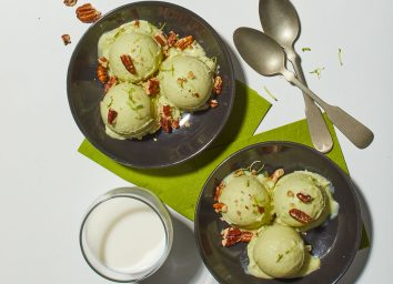 two bowls of avocado ice cream with spoons