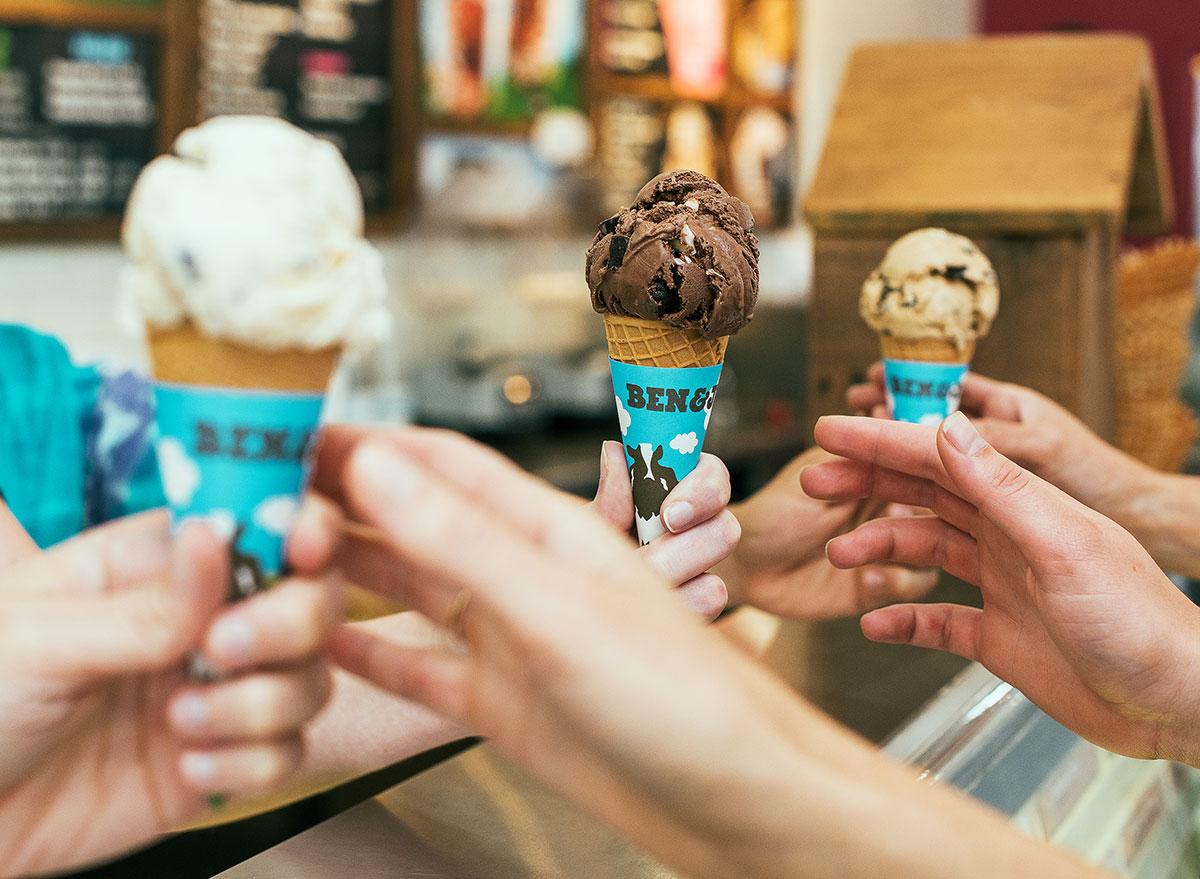 customers being handed ben and jerry's ice cream cones