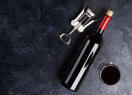bottle of leftover red wine on a dark counter top