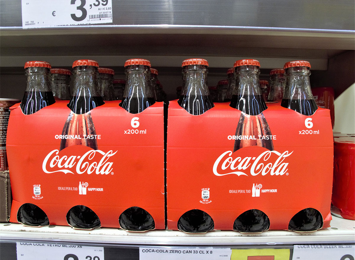 six pack of coke bottles