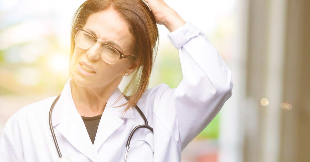 Doctor woman, medical professional doubt expression, confuse and wonder concept, uncertain future