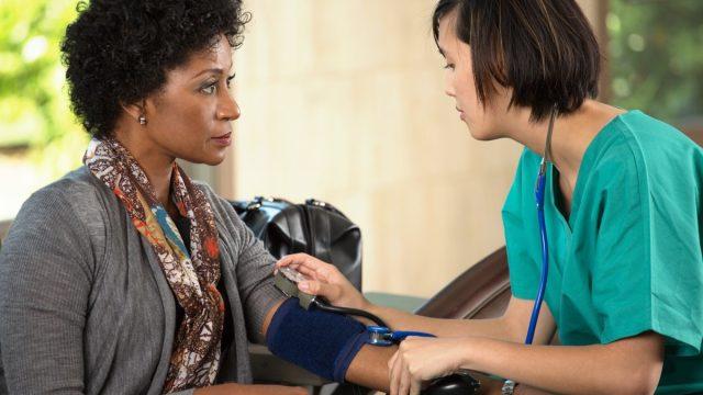 Nurse taking a patients blood pressure