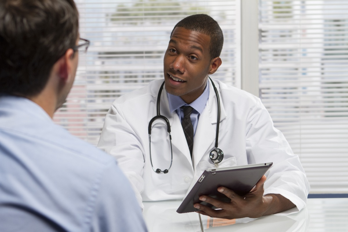 doctor consulting with patient, horizontal