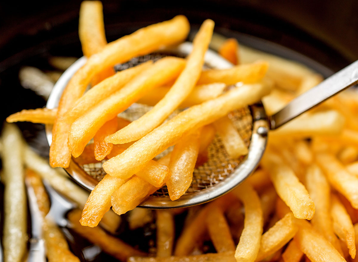 fast food fries coming out of fryer