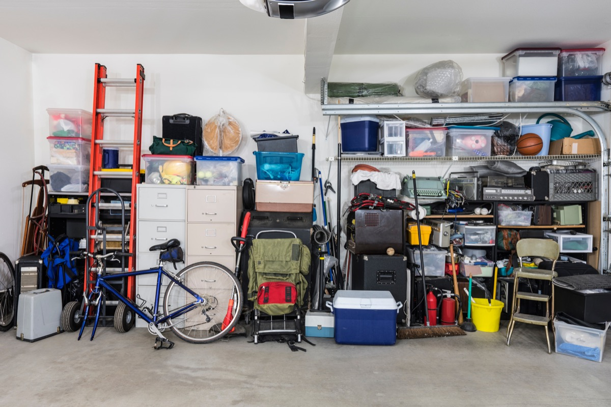 Garage storage shelves with vintage objects and equipment