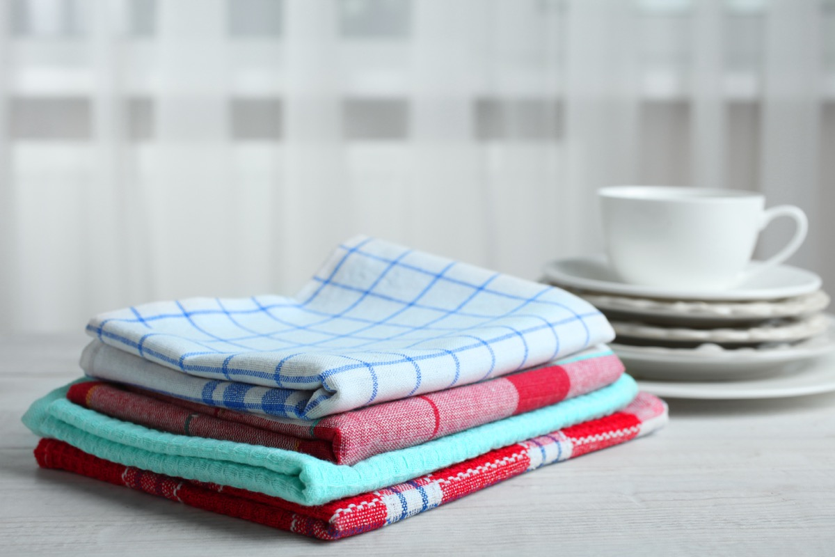 Kitchen towels and dishes on a wooden table