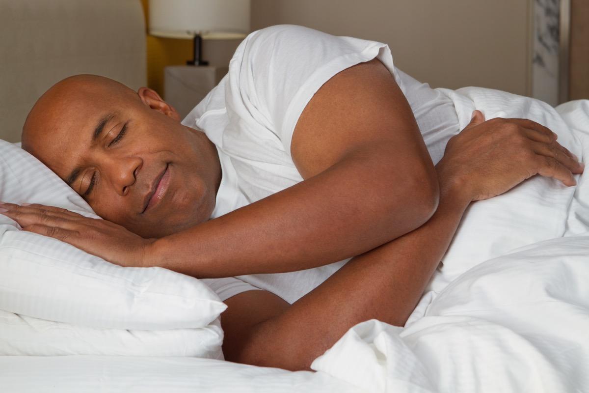 African American man fast asleep