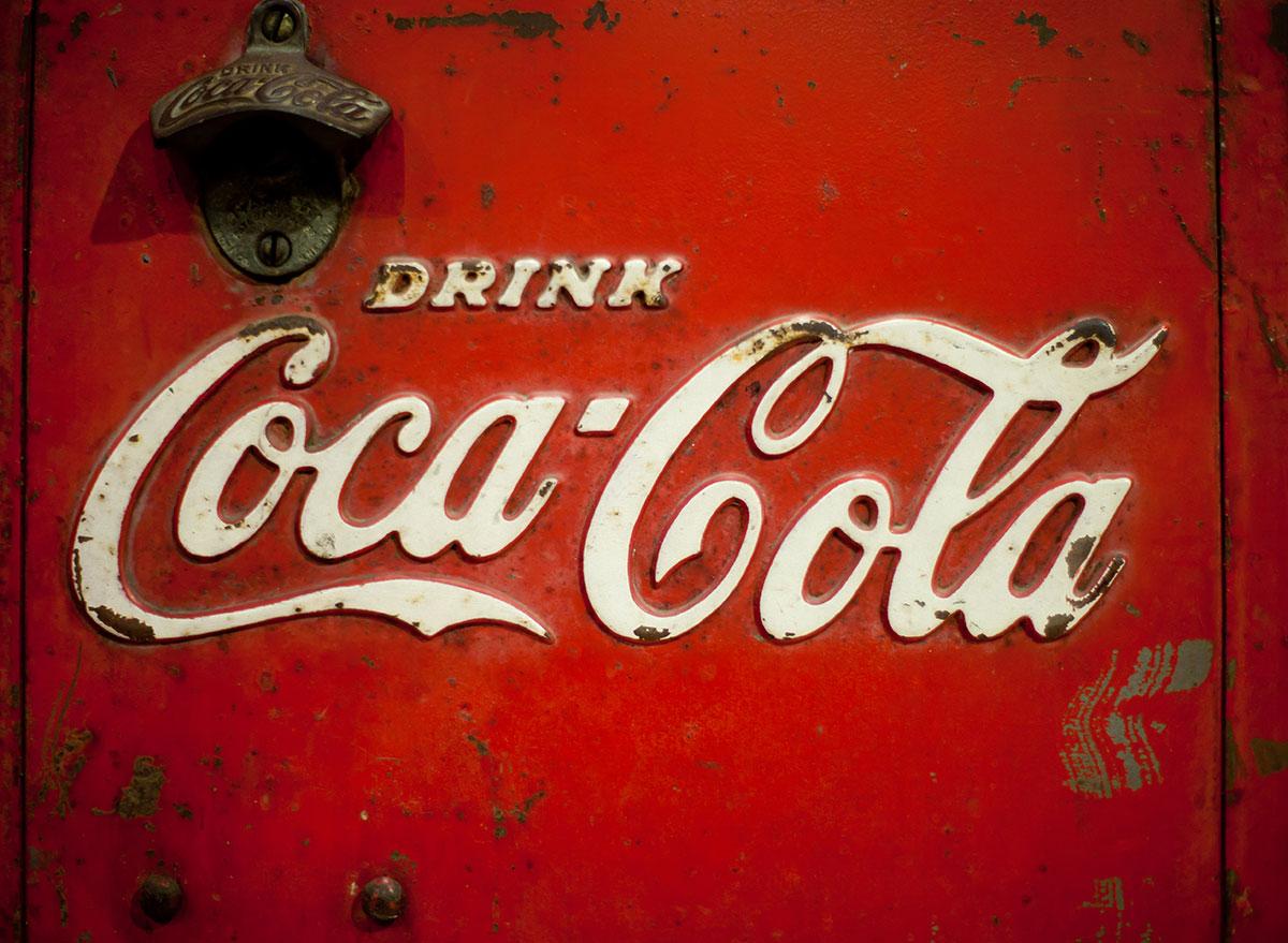 old coke opener on logo