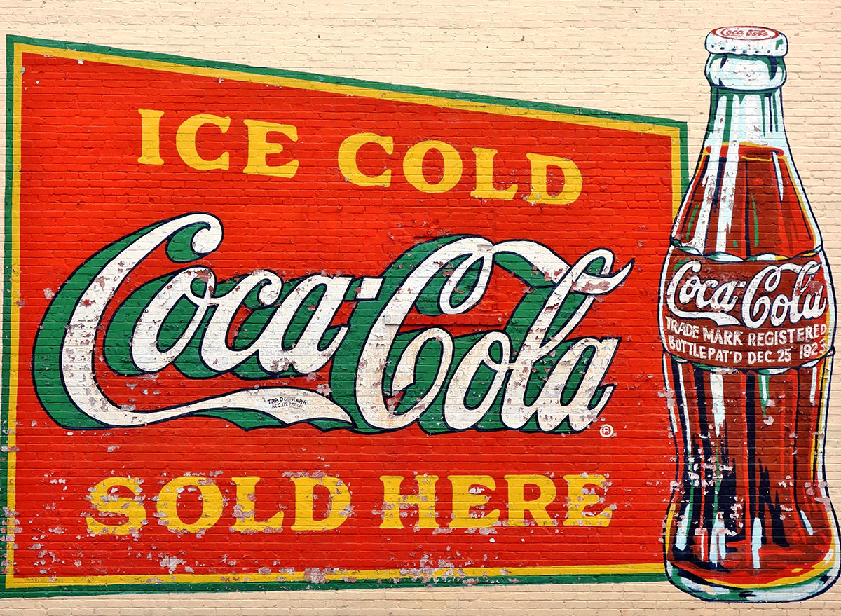 old painted coke logo wall
