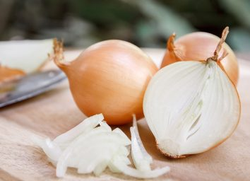 chopped onions on a cutting board