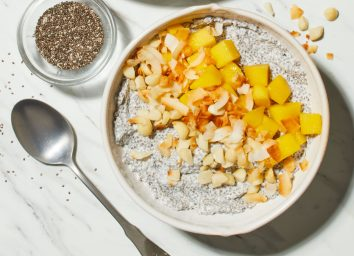 overnight chia pudding bowl with chia seeds on a marble counter