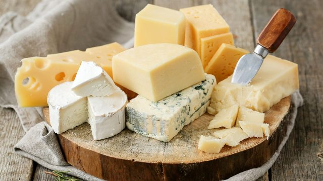 plate of many cheese on a cutting board