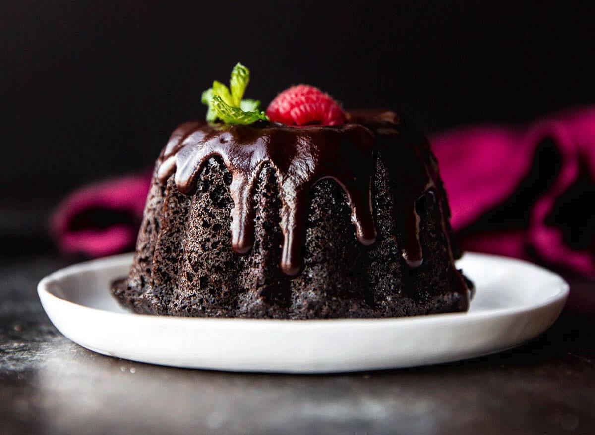 red wine chocolate ganache on a chocolate bundt cake with fruit
