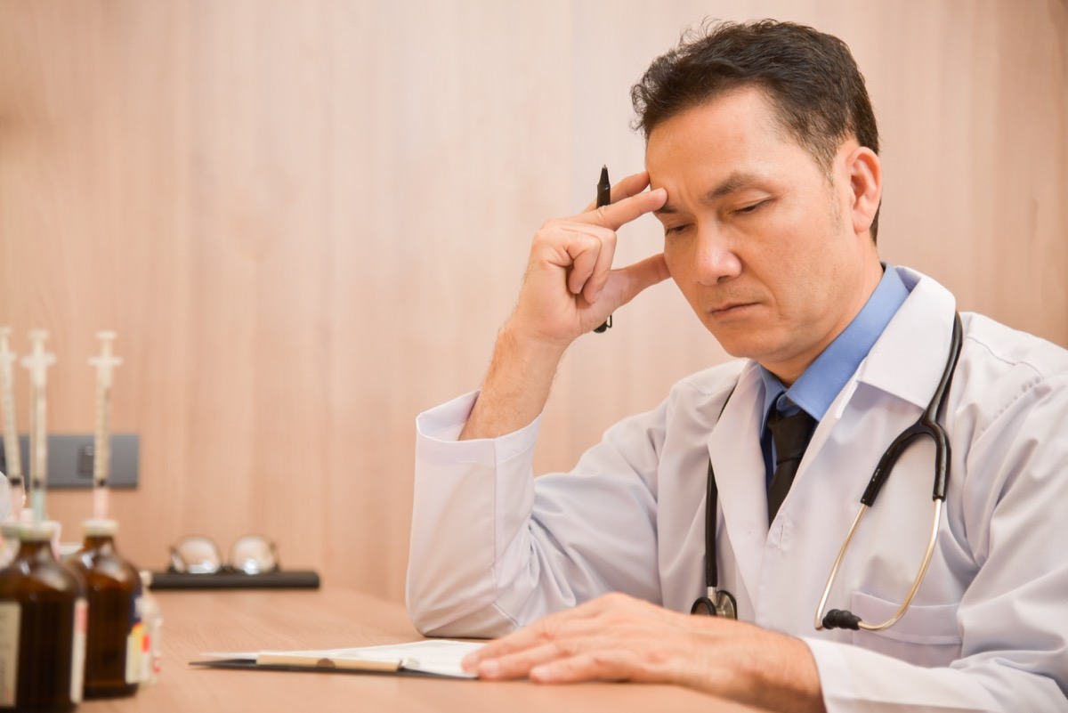 male doctor is thinking about result of examination of his patients