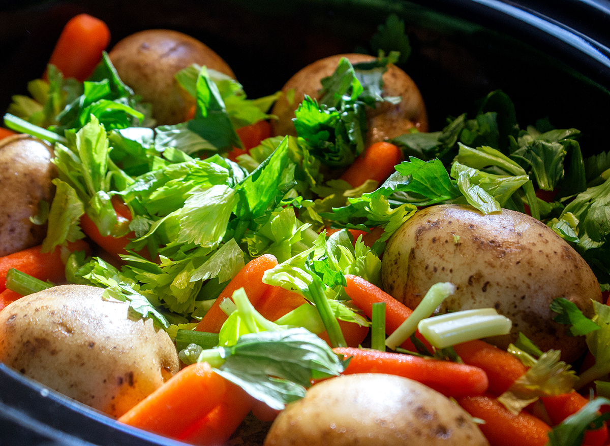 vegetables and herbs in slow cooker