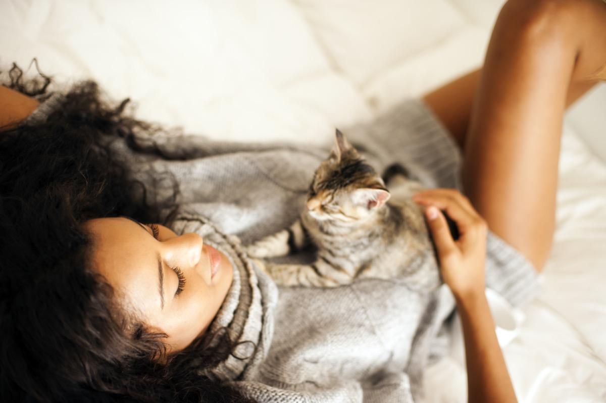 woman with cat indoors