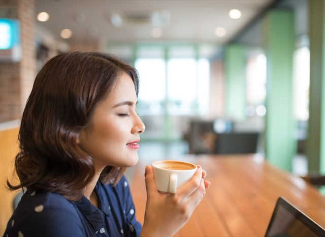 young asian woman drinking coffee