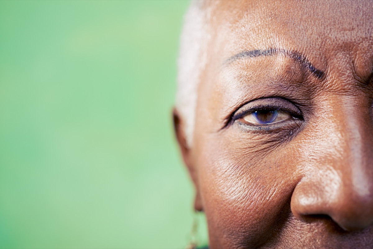 woman portrait, close-up of eye and face on green background