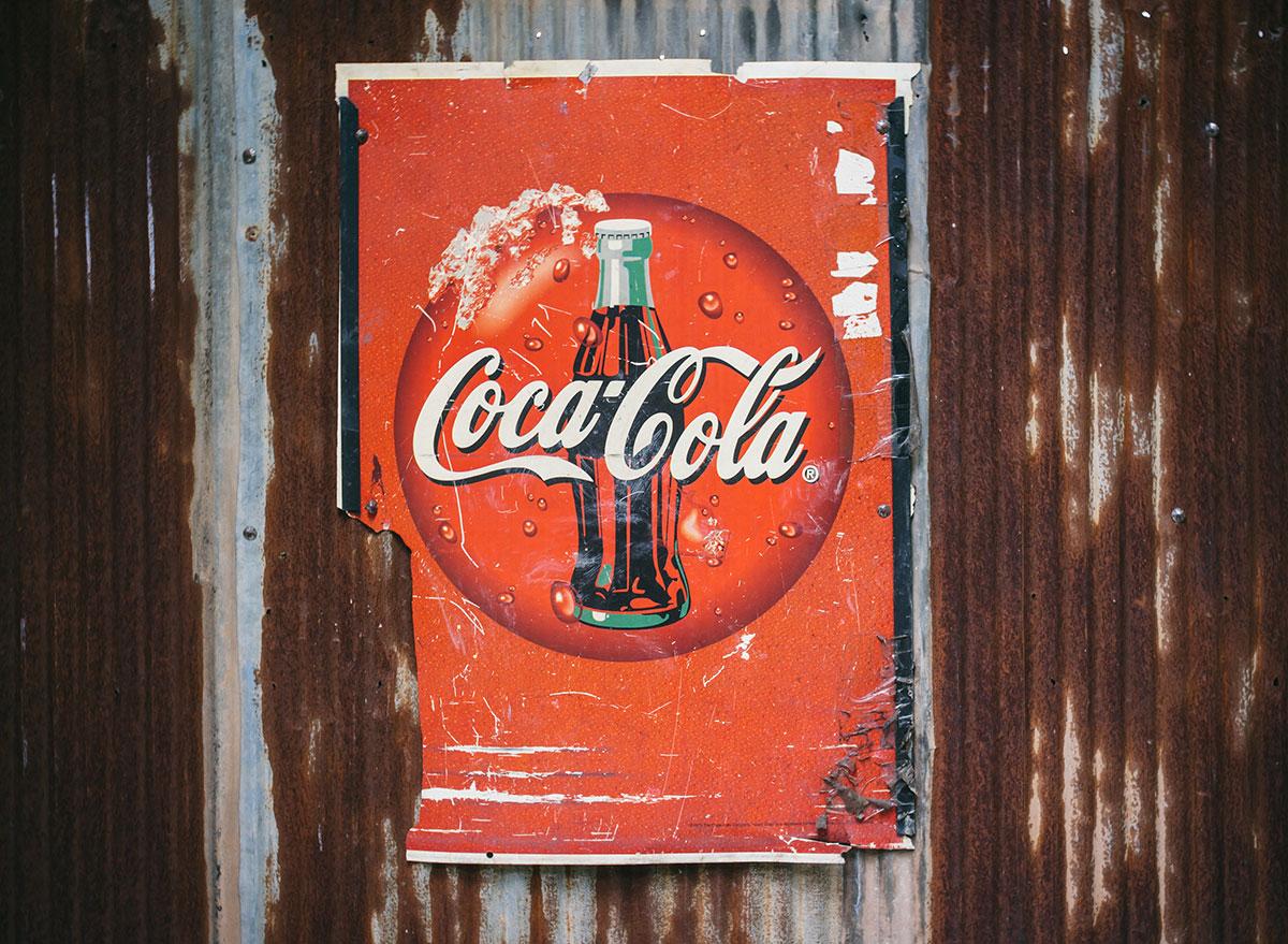 worn down vintage coke ad