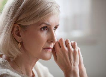 serious anxious mature senior woman