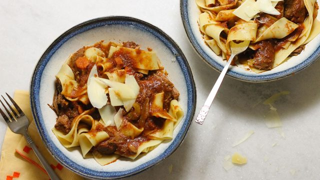 Crock pot beef ragu recipe with pappardelle pasta and shaved parmesan