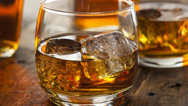glass of bourbon on the rocks